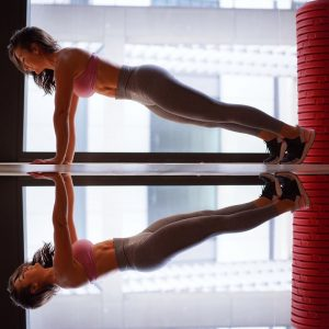 Personal trainer performing a high plank